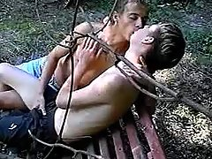 Guys secluded in park to enjoy oral