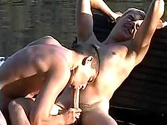 Five boys sucking on wooden bridge